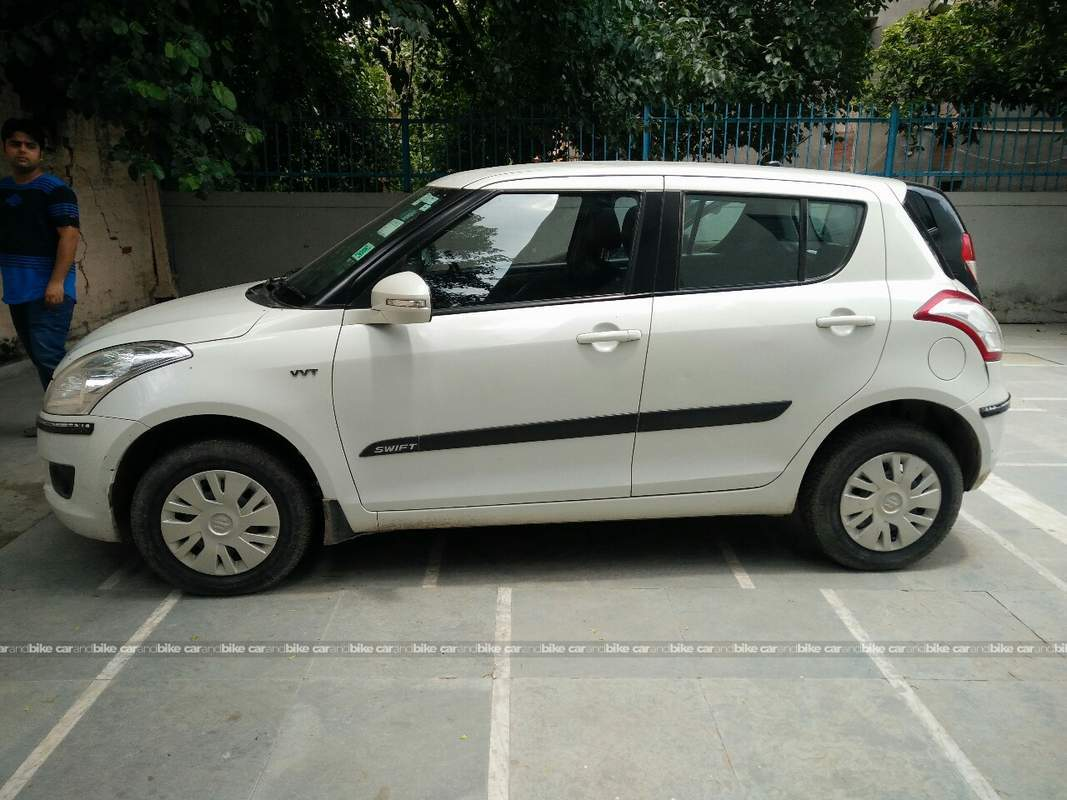 Used maruti suzuki swift vxi in new delhi 2014 model for Swift lxi o interior