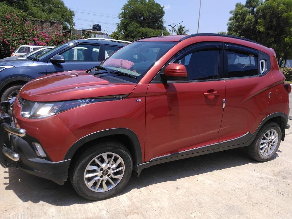 Mahindra Kuv100  Left Side View